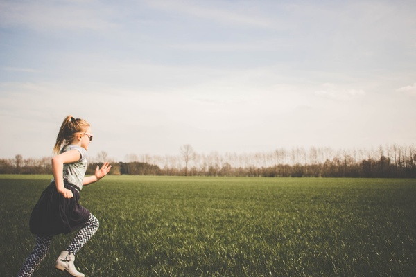 Girl in field running